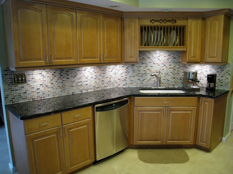 Kitchen with appliances including drip and espresso coffee makers
