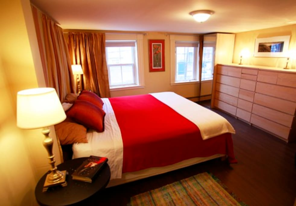 The lovely master bedroom is spacious, even with the king-sized bed