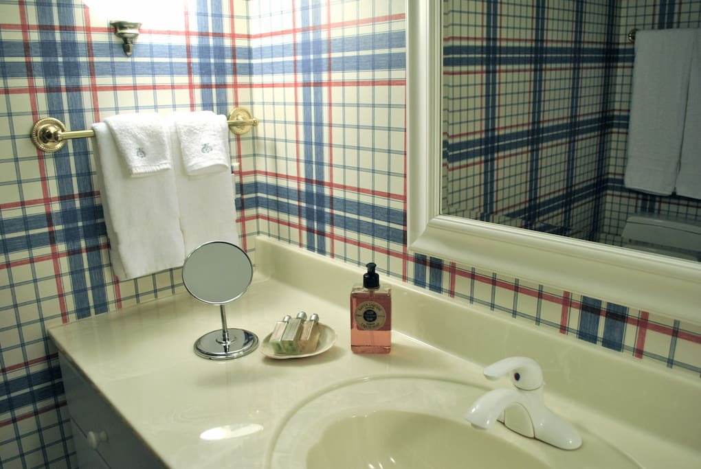 Private full bathroom with shower cubicle, lavatory, vanity. 2 sets of bath towels provided, amenities and hair dryer. Beach towels also provided.
