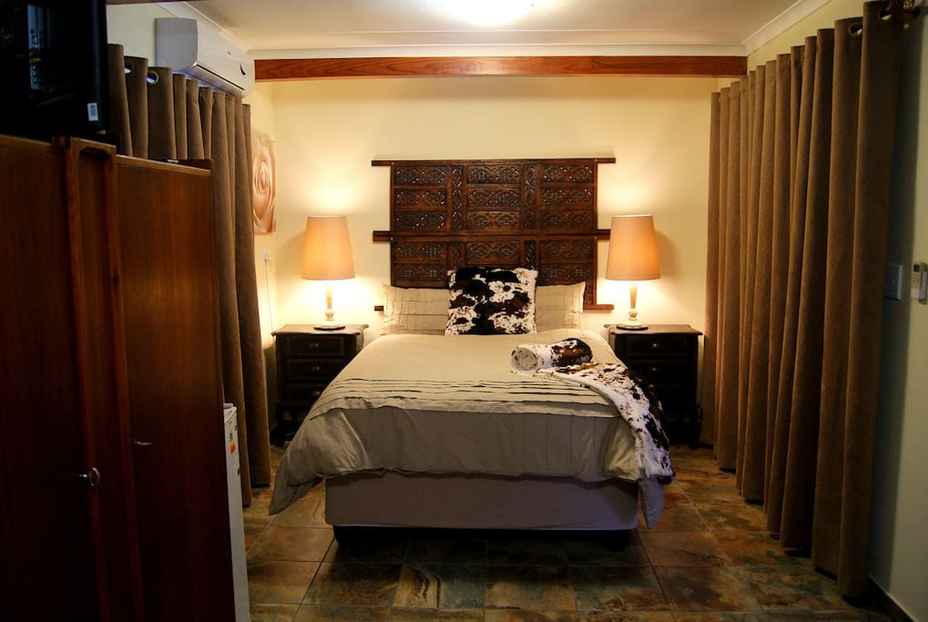 Our Nguni room is a luxury room in the bottom of the garden and can accommodate up to 3 persons
