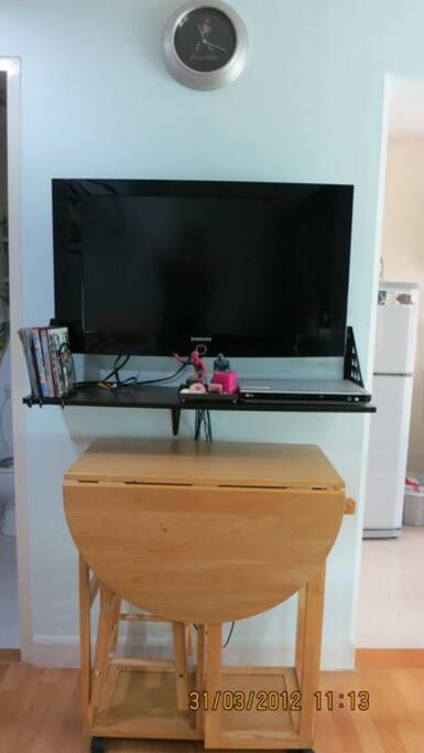 TV and foldable dining table set.