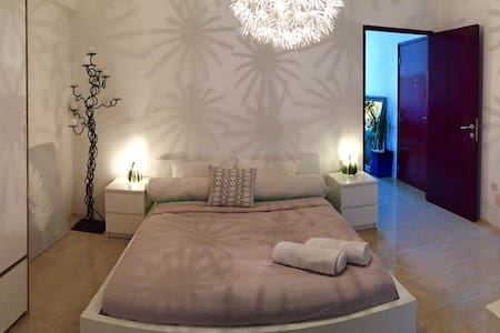 Boutique ensuite room, by the beach