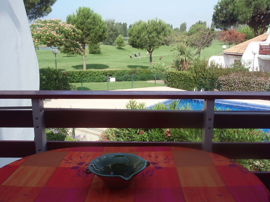terrace with view on pool and golf course