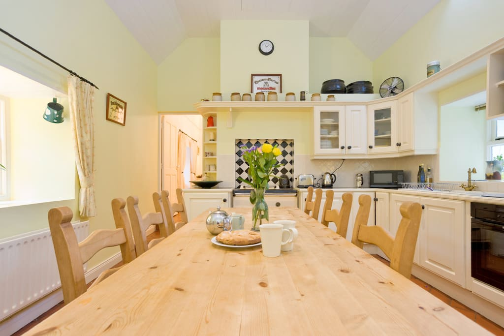 We love the kitchen -  a huge old Irish pine table and lots of seating for everyone.