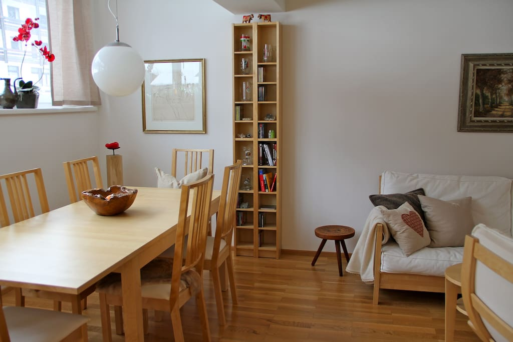 living/dining room with a sofa bed and a kitchenette
