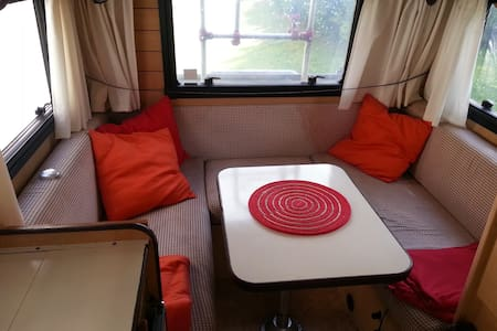 If you want to stay in the the City Center and not pay to much, you can do it in an old, but cool and comfortable camper!  Is has two beds, one set bed 120 cm and a sofa that you can make into a 150 cm bed. Sorry, but I don't rent it as a car.