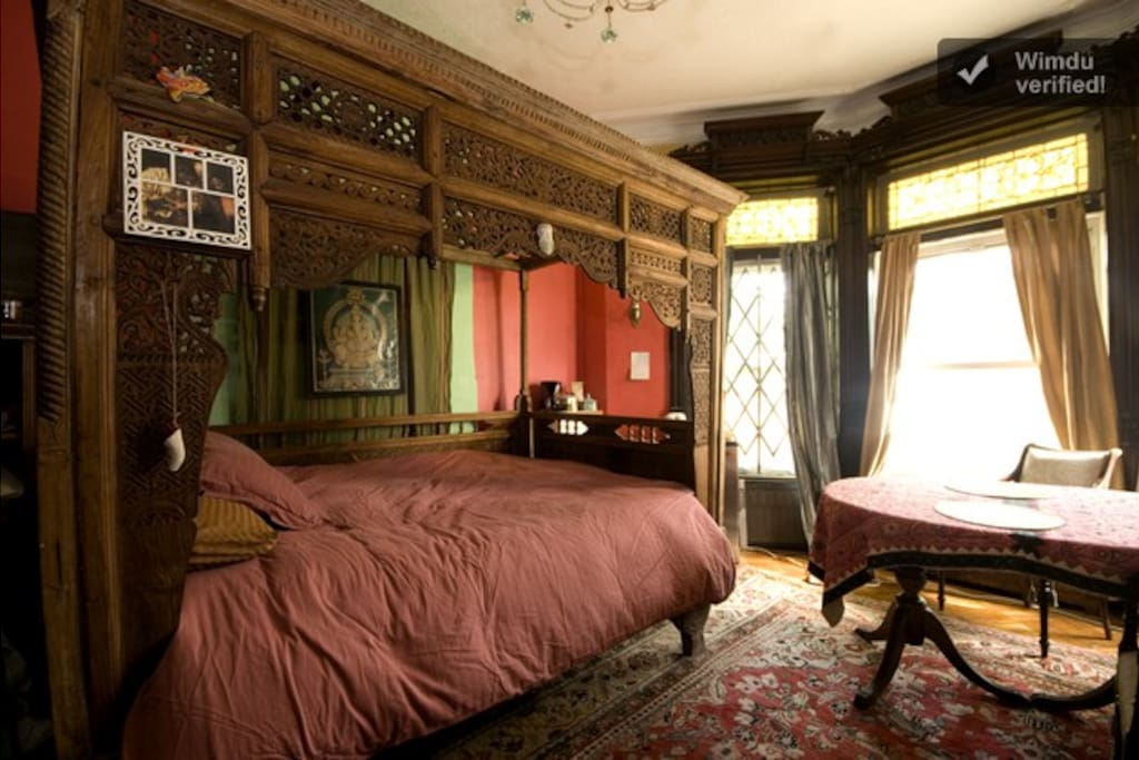 The Bed and the Table in the Red Room