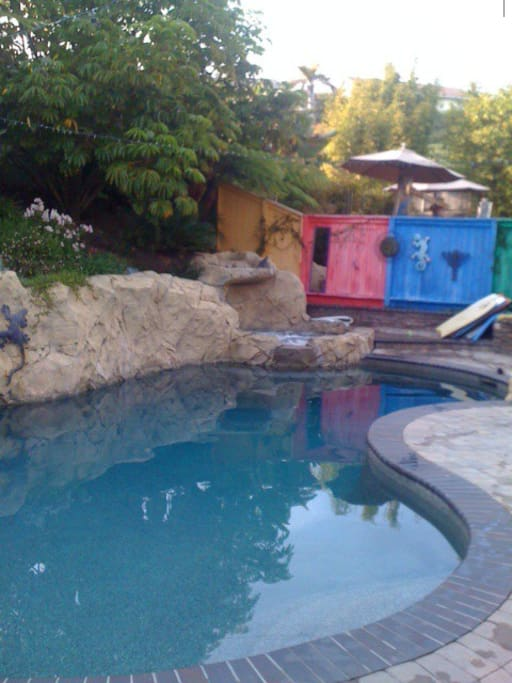 Salt water pool/hot tub with water fall