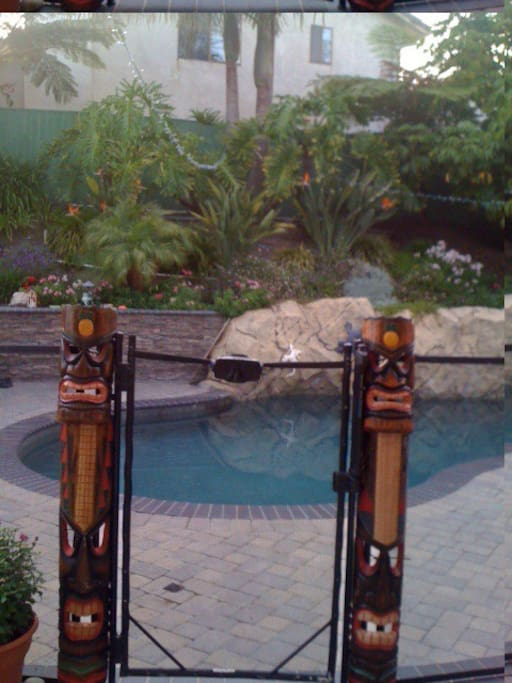 Pool entry, there is a gate surrounding the pool area