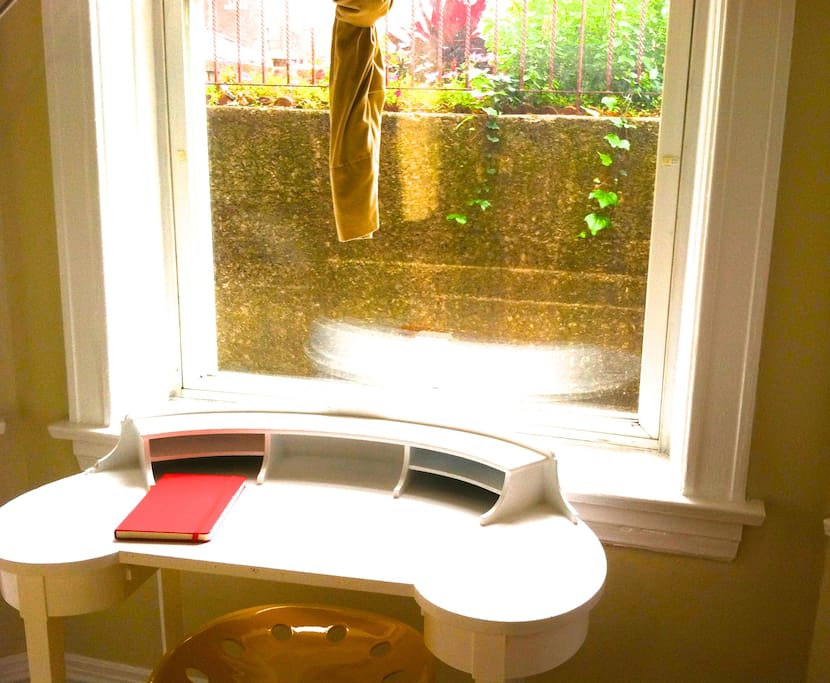 Your quaint antique writing desk overlooks the courtyard, so you can study or work with a view of the street.