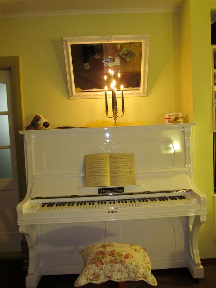 Yes, there is a 1939 Ephraim Rapp piano, and if you're a musician, you would be welcome to play.