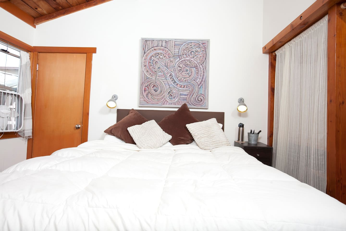 Master bedroom (you don't see the vaulted 15 foot ceilings of natural wood.) Super comfy Queen bed in Private Suite. Best sleep of your life!