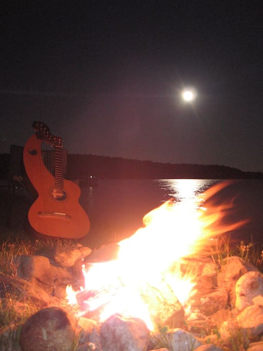 Sit by the beach firepit and play guitar