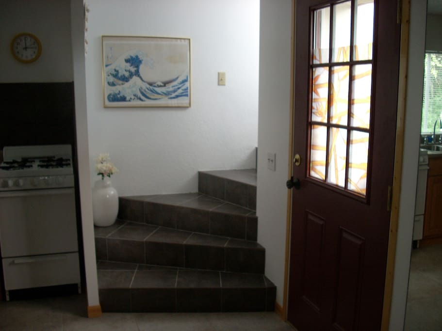 Tile stairs to full bathroom.