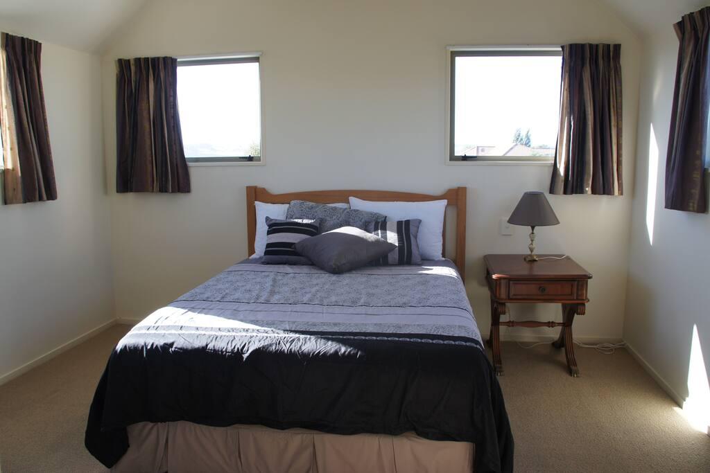 Sunny master bedroom has ensuite shower & toilet