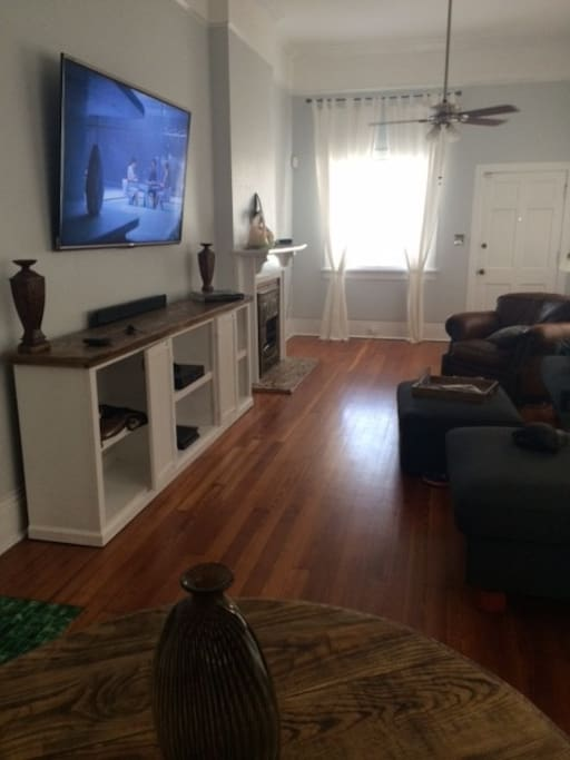 "70"" TV, comfy couch and chair"