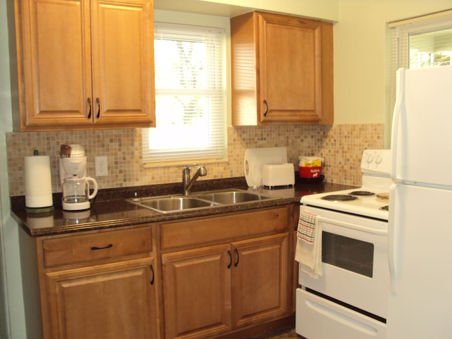 Newly upgraded fully equipped kitchen. New appliances. New front load washer/clothesline outside.