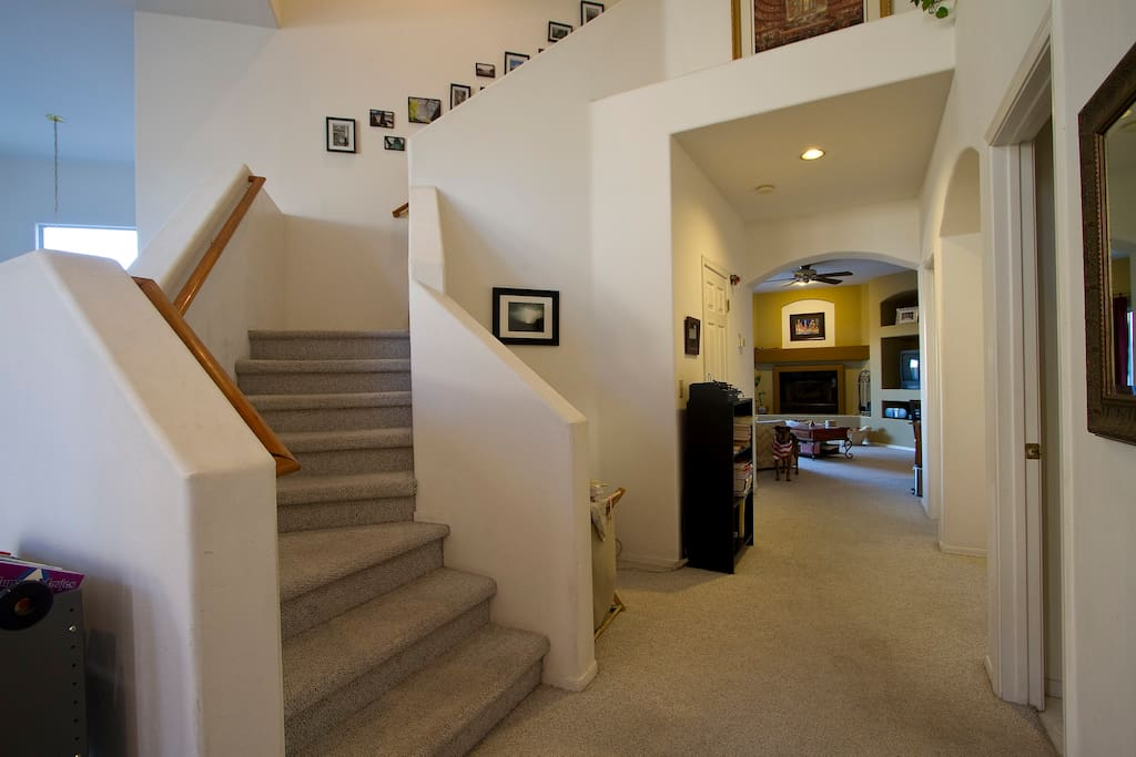 Front hallway.  Guest rooms are right up the stairs.