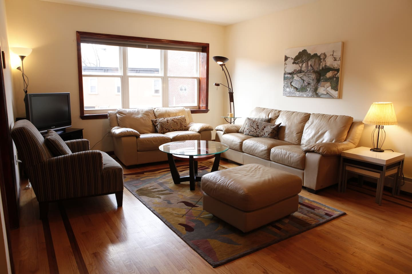 This is the Living Room. Nice light from the West-facing window, comfortable furniture, TV/Cable/DVD.