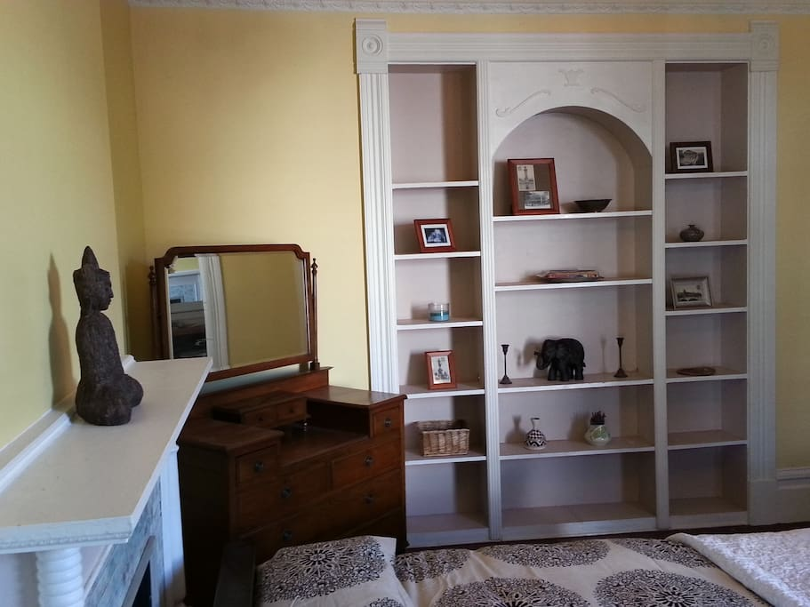 1st bedroom. Shelves, Queen Anne vanity chest of drawers