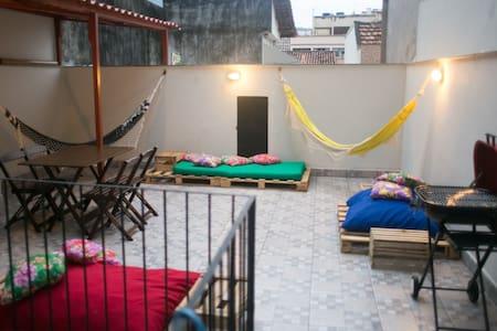 Quarto em casa em Botafogo
