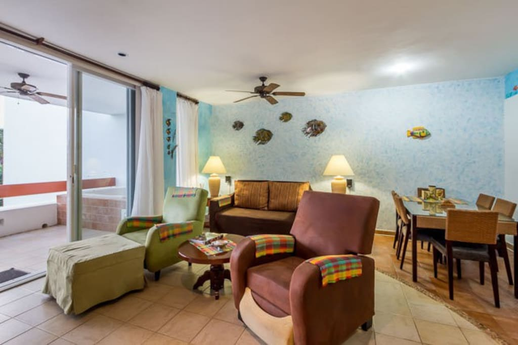 The combined living and dining space has comfortable seating and a table with seating for 6