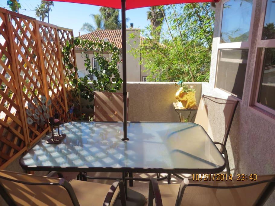 Enjoy your dinner on shaded balcony.