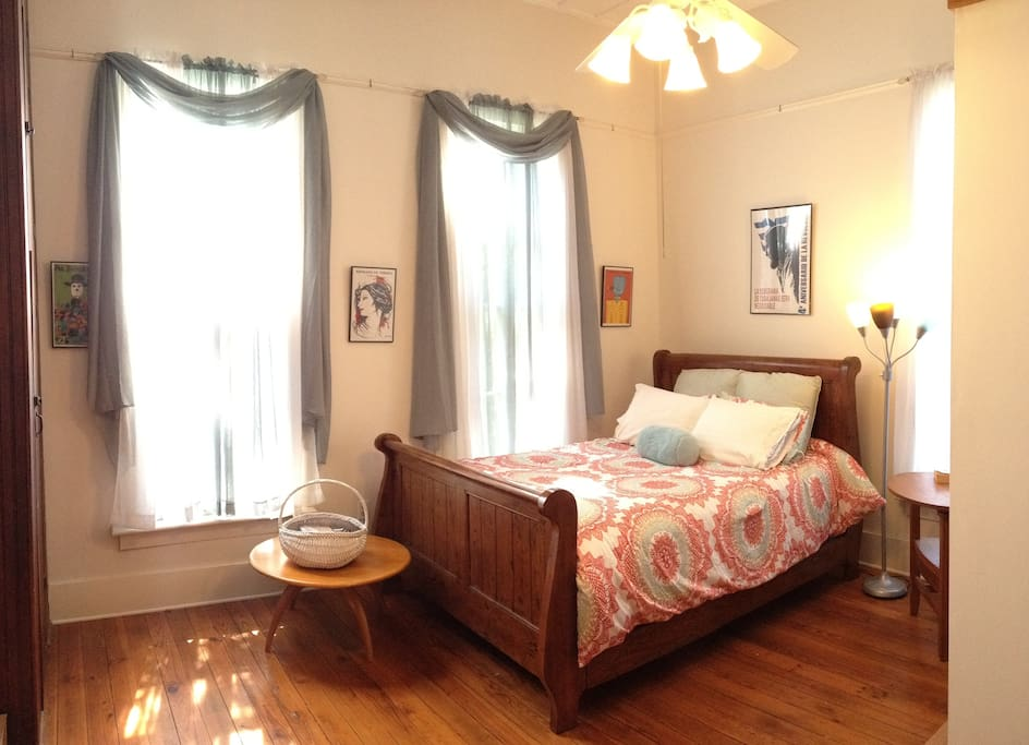 Kate's Room has a queen sleigh bed and large windows with natural light