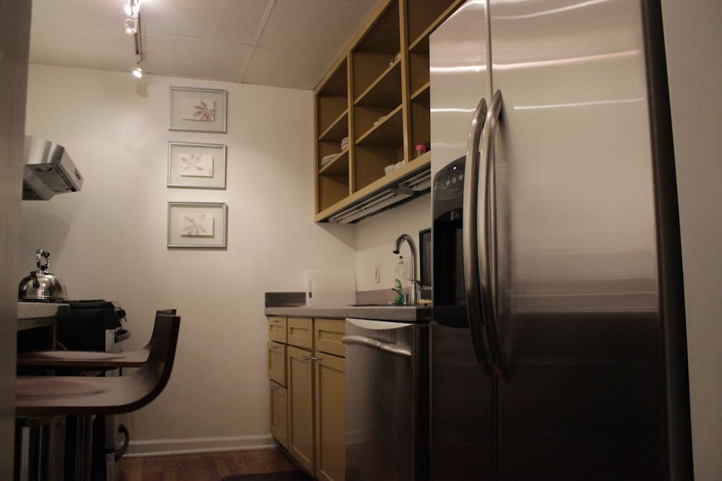 Galley style kitchen has all the dishes needed for a great stay and a dishwasher to clean the dishes!