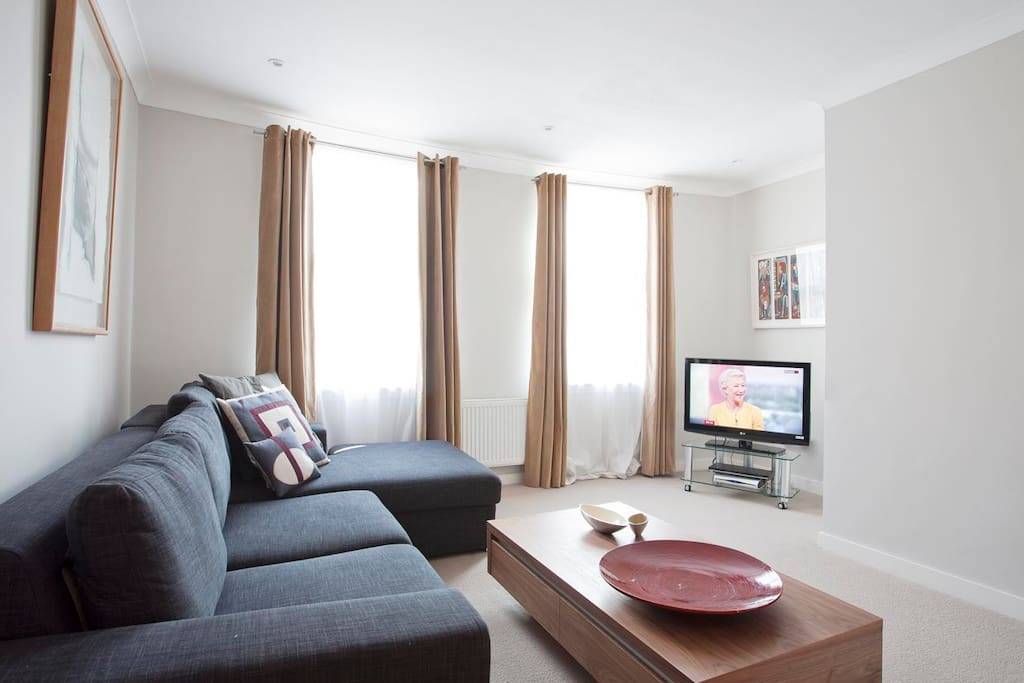 Large living room with beautiful art , Sky cable tv  and Wifi throughout the house