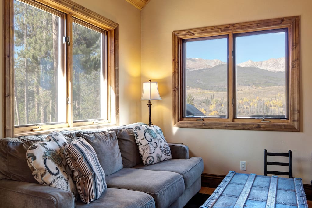 A cozy living room with plenty of seating and great views