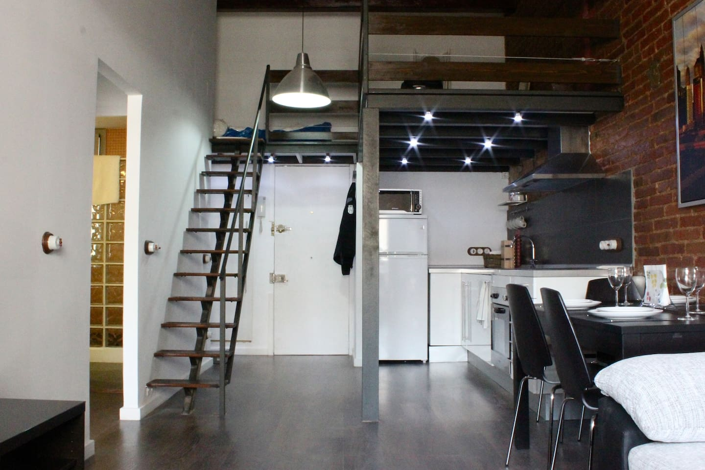 Kitchen, entrance and the gallery (sleeps 2 in a sofa-bed)