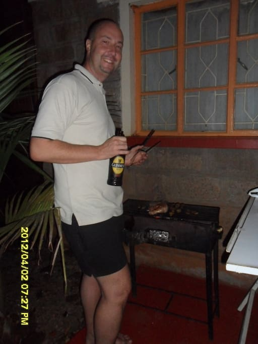 one of my guest enjoying his barbecue and guinness in the garden!!!