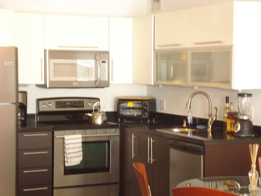 Granite and stainless kitchen, coffee maker, blender, toaster oven