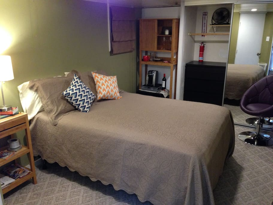 Airbnb only takes pictures once. So please excuse my photography skills. This photo was taken on 11/5/14. We've improved the room to make it even more comfortable. Our guests enjoy a full size mattress (protected with a hypoallergenic dust mite control ca