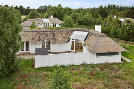 Situated only few minutes walk from the magnificent west coast of Denmark.   The house has 4 bedrooms, access to indoor swimming pools, tennis courts and playground.