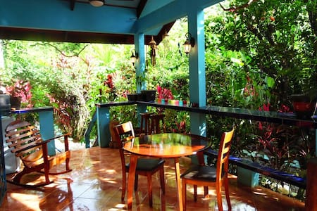 Casa Azul is a comfortable one bedroom house with 2 orthopedic beds, one queen, one twin. Full kitchen, large private deck, on site caretakers, laundry service. Less than  a 5 minute walk to the beach, river & point break surf. Bike to market 5 mins.