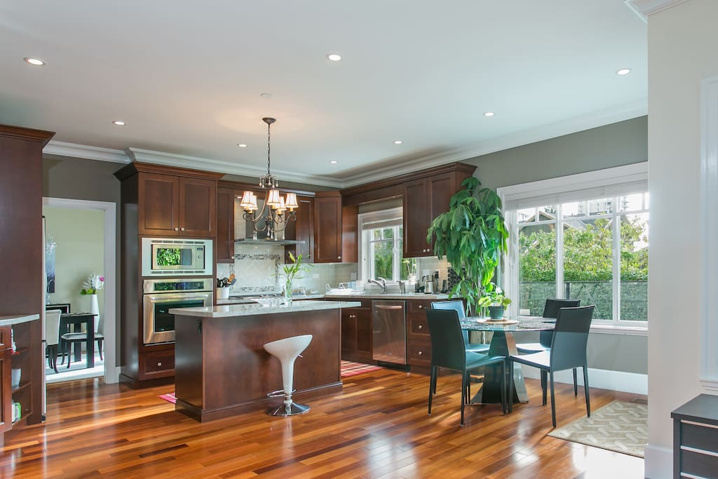 Fully stocked custom kitchen and Casual dining space