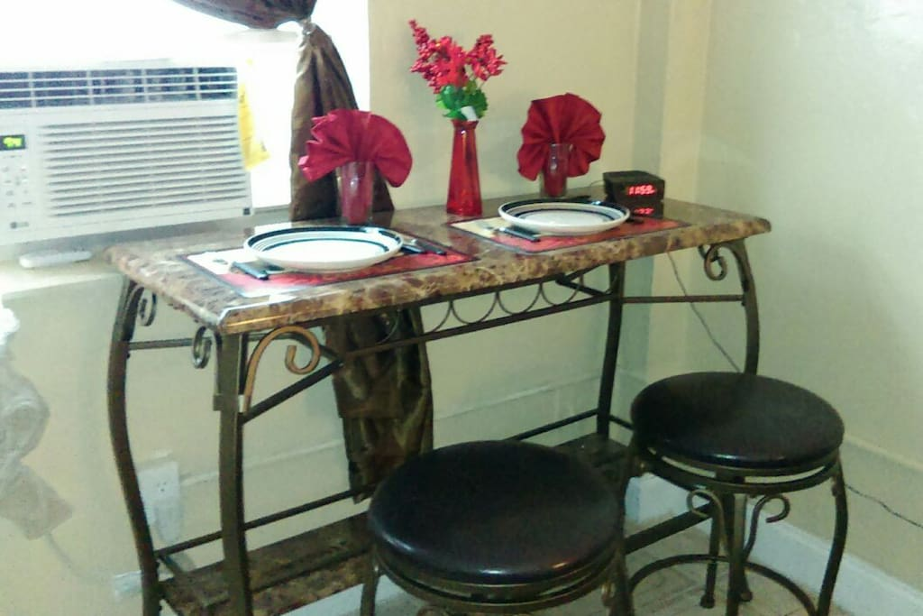 Table set for two. Has wine rack for those romantic evenings.