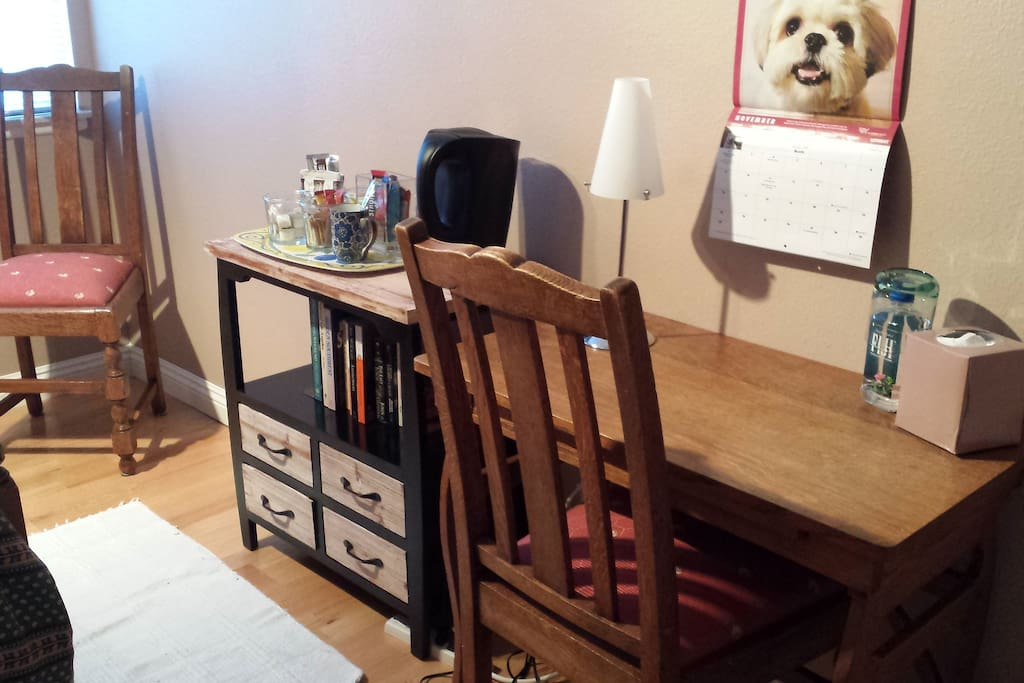 A writing desk where you can set up your laptop.