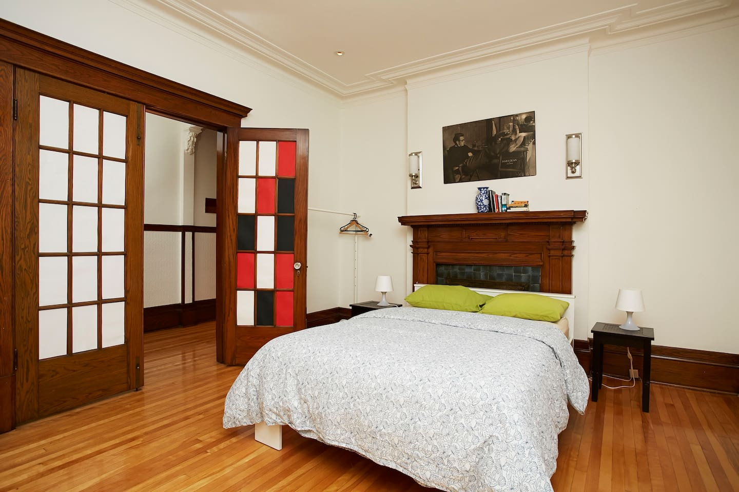 Rooms #1 and #2: Large space with two rooms, each with a double bed. The rooms are separated by a large French door and curtains. Each room has its private entrance.