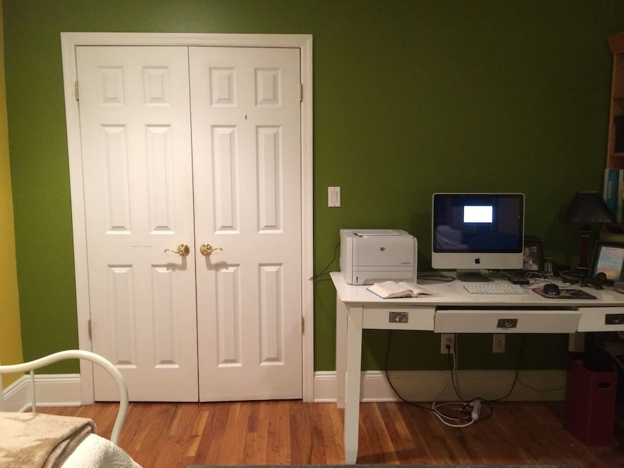 This is the closet, which is quite large, and has plenty of space for your belongings. The room doubles as my personal office when it's not used as a guest room.
