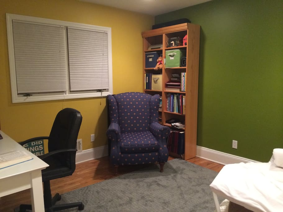The desk has a very comfortable ergonomically designed chair, with great lumbar support for your back. The blue and gold chair is great for curling up with your favorite book, or one of mine. Two large windows open up to a sunny side yard.