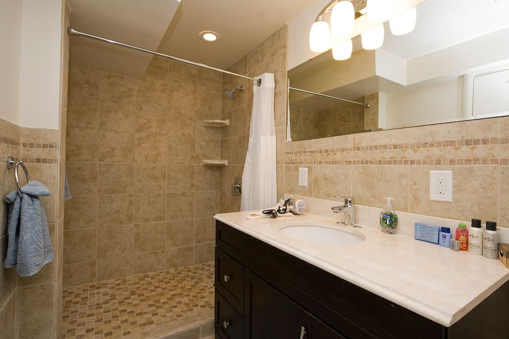 Newly remodeled bath with spacious shower, new fixtures and heated floor tiles.