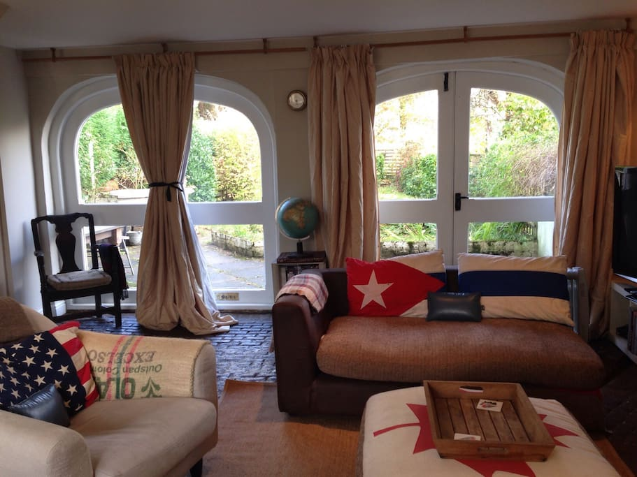 Living room with original arches from Volcano's history as a coach house