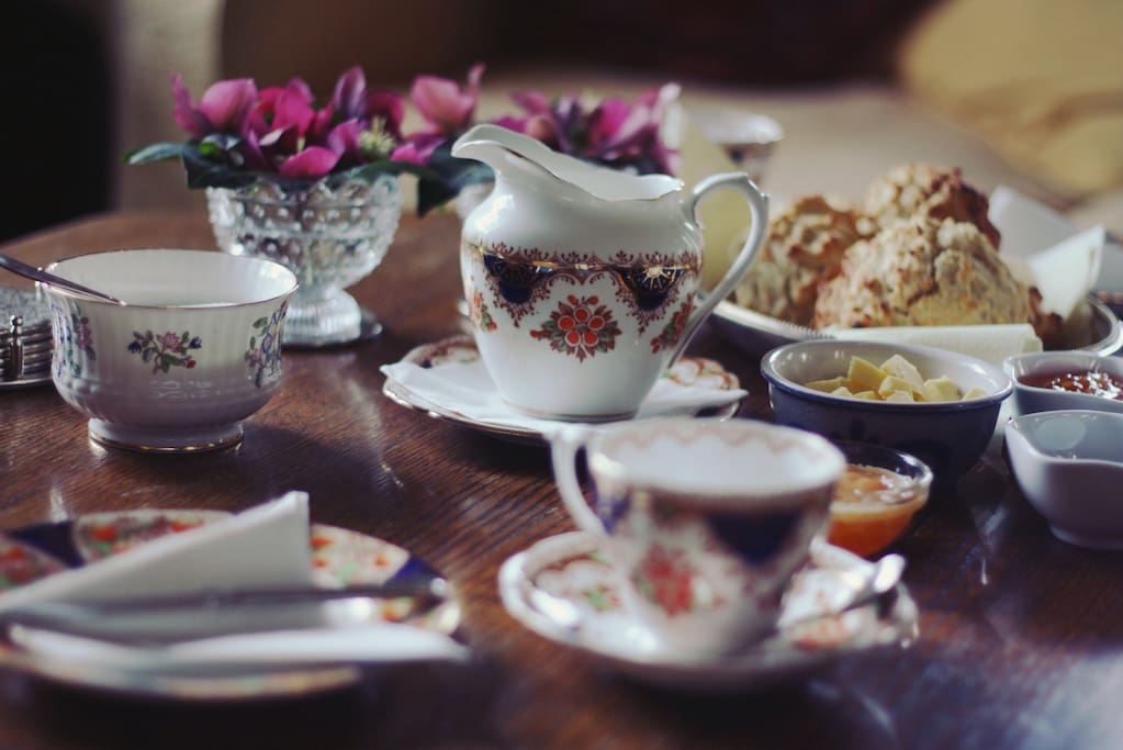 Your welcome: tea / coffee and home made scones served on our vintage china.