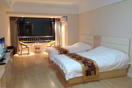 青岛黄岛区金沙滩黄海学院旁东方影都海景度假公寓 - Qingdao - Lejlighed