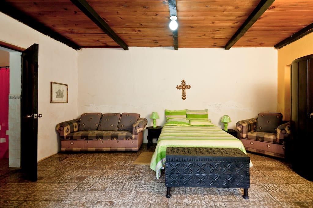 Master room, sofas, tv, closet, bathroom