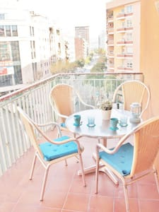 Cozy Loft with a very nice terrace in Barcelona. The flat is very well situated close to Sants station that is metro and train and  fully equipped with a/c, wifi, fully equipped kitchen etc.. The neighborhood is smart with bars, restaurants shops.