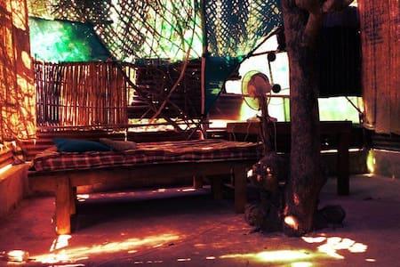 Hut built around tree @Cirrus Goa - Kunyhó